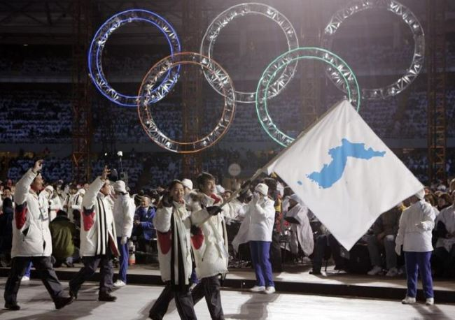 In this Feb. 10, 2006, file photo, Korea flag-bearer`s Bora Lee and Jong-In Lee, carrying a unification flag lead their teams into the stadium during the 2006 Winter Olympics opening ceremony in Turin, Italy. (AP)