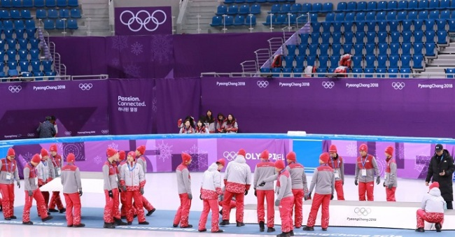 PyeongChang staff check for the best position to place medal podium at the Gangneung Ice Arena Friday. (Yonhap)