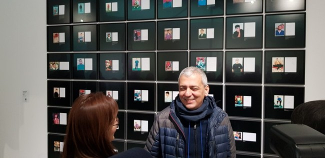 Akram Zaatari talks about his collection of photographs at the Gangwon International Biennale 2018, in Gangneung, Gangwon Province, Friday. (Shim Woo-hyun/The Korea Herald)
