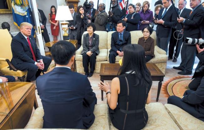 US President Donald Trump (left) meets with North Korean defectors in the Oval Office of the White House in Washingtonon Friday. (EPA-Yonhap)