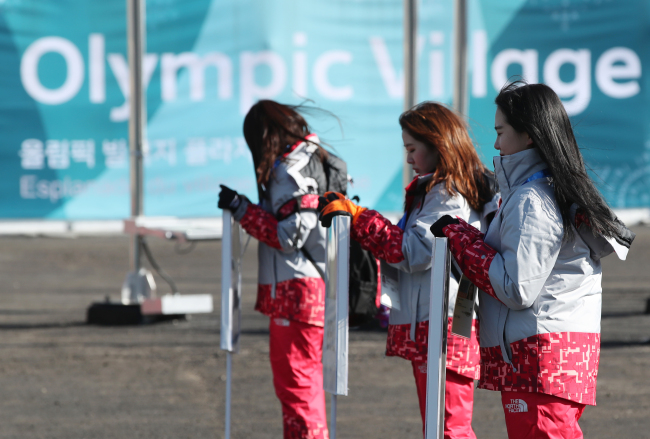 Olympic volunteers at the Olympic village in PyeongChang, Gangwon Province. Yonhap