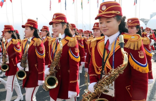 A female marching band from North Korea performs at the athletes' village in Gangneung, Gangwon Province, Thursday. (Yonhap)