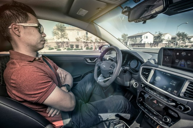 An engineer takes his hands off the steering wheel during a demonstration of the self-driving Ioniq in Las Vegas. (Hyundai Motor)