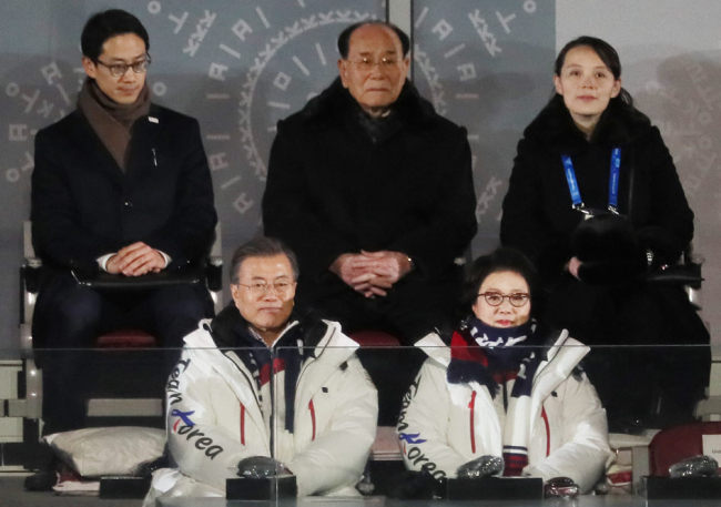 South Korean President Moon Jae-in (left, front row), first lady Kim Jung-sook, North Korean ceremonial head of state Kim Yong-nam (second from right, back row) and North Korean leader Kim Jong-un`s sister Kim Yo-jong (right, back row) attend the opening ceremony of the 2018 PyeongChang Olympics in PyeongChang, Gangwon Province, Friday. (Yonhap)