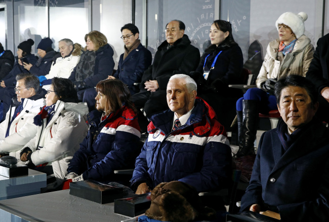 US Vice President Mike Pence, second from bottom right, sits between second lady Karen Pence, third from from bottom left, and Japanese Prime Minister Shinzo Abe at the opening ceremony of the 2018 Winter Olympics in Pyeongchang, South Korea, Friday, Feb. 9, 2018. Seated behind Pence are Kim Yong-nam, third from top right, president of the Presidium of North Korean Parliament, and Kim Yo-jong, second from top right, sister of North Korean leader Kim Jong-un. (Yonhap-AP)