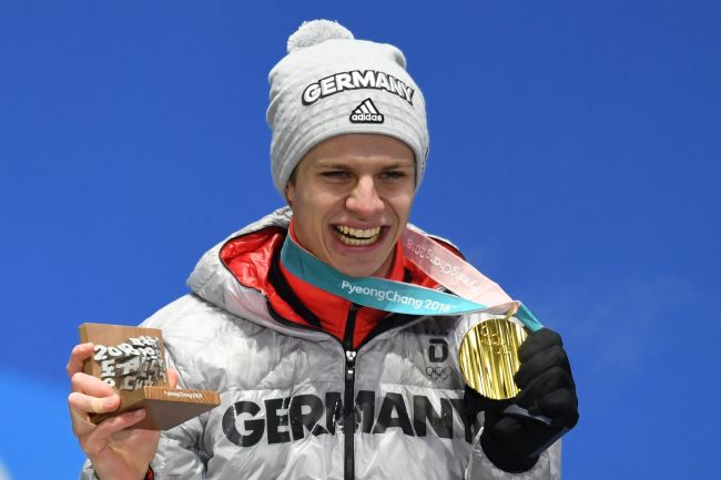 Gold medalist Andreas Wellinger of Germany who gold in ski jumping celebrates during the victory ceremony. Yonhap