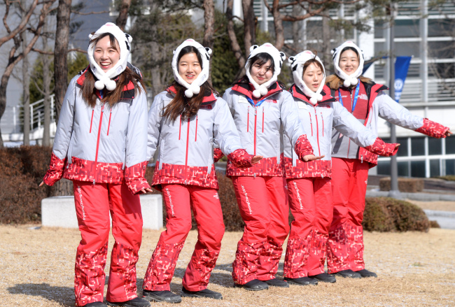 Olympic volunteers who danced in a giant circle at the opening ceremony of the Feb. 9 PyeongChang Winter Olympics display some of their coordinated dance moves Monday in an interview with The Korea Herald. Park Hyun-koo/The Korea Herald