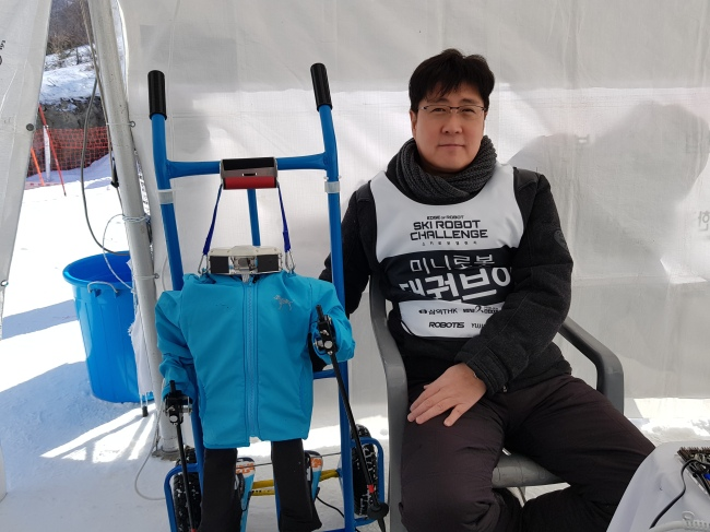 Sam Lee, director of tech sales at Mini Robot Corp. which developed Taekwon V, the robot that won the self-driving skiing mission on Monday (Sohn Ji-young/The Korea Herald)