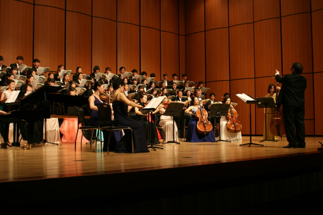 The GIC choir and professional musicians perform in its 2014 May concert. (GIC)