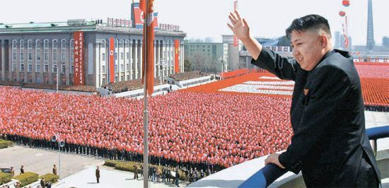 North Korea`s leader Kim Jong-un waves to the crowd gathered for a military parade last April. Yonhap