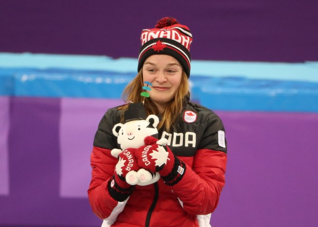 Bronze medal winner Kim Boutin of Canada celebrates during the venue ceremony of the Women's Short Track Speed Skating 500 m final at the Gangneung Ice Arena during the PyeongChang 2018 Olympic Games, Tuesday. (Yonhap)