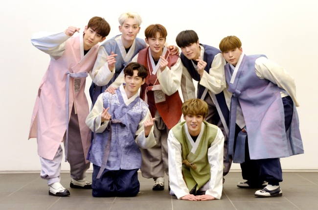 VAV poses after an interview with The Korea Herald in Seoul on Tuesday, wearing Korean traditional dress hanbok to celebrate the Lunar New Year holiday. (Park Hyun-koo / Korea Herald)