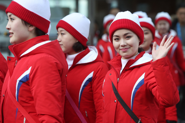 Cheerleaders from North Korea leave Inje Speedium Hotel located in Inje, Gangwon Province, to cheer for North Korean alpine skiers at the men's giant slalom games.