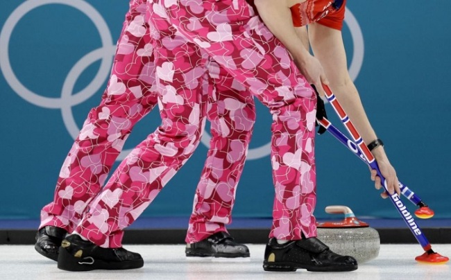 The men's curling team from Norway wears Valentine's Day-themed pants for their match Wednesday. (AP)