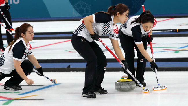 Korea`s female curling team competes in their match with Sweden at Gangneung Curling Centre, located in Gangneung, around 240 kilometers east of Seoul, on Feb. 19, 2018. (Yonhap)