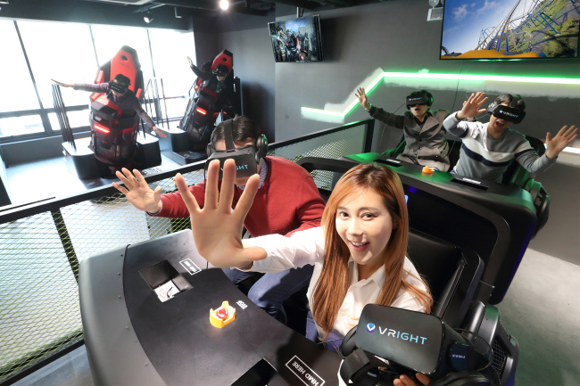 Models test out virtual reality gaming systems at VRIGHT, a virtual reality theme park from KT and GS Retail set to open March 1. (KT)