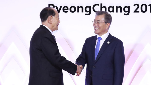 South Korea`s President Moon Jae-in shakes hands with North Korea`s nominal head of state Kim Young-nam at opening reception ceremony for PyeongChang Olympics on Feb. 9.