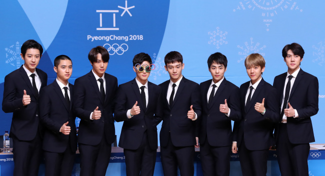 K-pop band EXO poses for the camera during a press conference held at PyeongChang Olympic Main Press Centre at Alpensia Resort in PyeongChang on Feb. 21, 2018. (Yonhap)