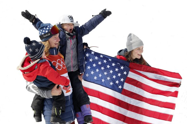 American gold medalist David Wise celebrates on the podium with wife Alexandra and children Nayeli and Malachi during the victory ceremony for the men's ski halfpipe event during the PyeongChang 2018 Winter Olympic Games at Phoenix Snow Park in PyeongChang, Gangwon Province, Thursday. (Reuters-Yonhap)