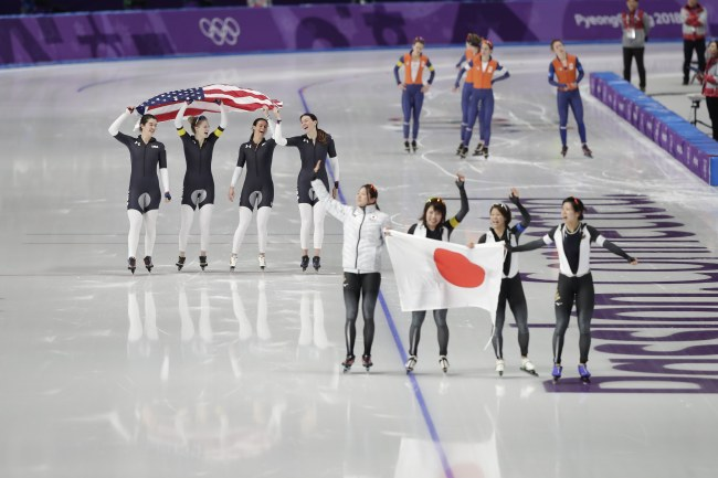Gold medalists Team Japan (right) and bronze medalists Team USA (left) react after the Women's speedskating team pursuit competition at the Gangneung Oval during the PyeongChang 2018 Olympics on Thursday. (EPA-Yonhap)