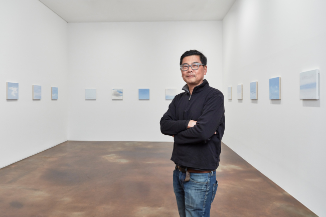 Byron Kim poses with his Sunday Painting series at Kukje Gallery in Seoul (Kukje Gallery)