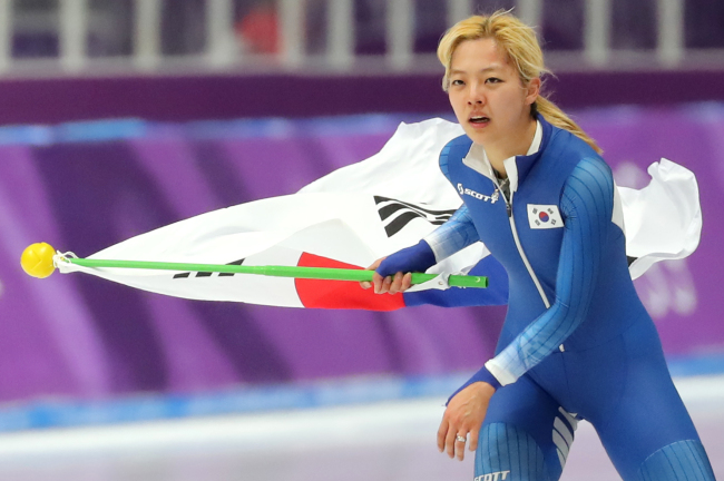 Despite brewing scandals about her possibly bullying a fellow speedskater, Kim Boreum went ahead to run in the women`s mass start speedskating and brought back home a silver medal (Yonhap)
