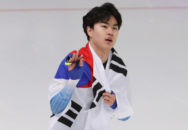 Kim Min-seok won a bronze in the men`s 1500-meter speedskating. The 18-year-old is now the first Asian skater to make a podium finish in the men's 1,500m distance in the Winter Olympics.(Yohap)