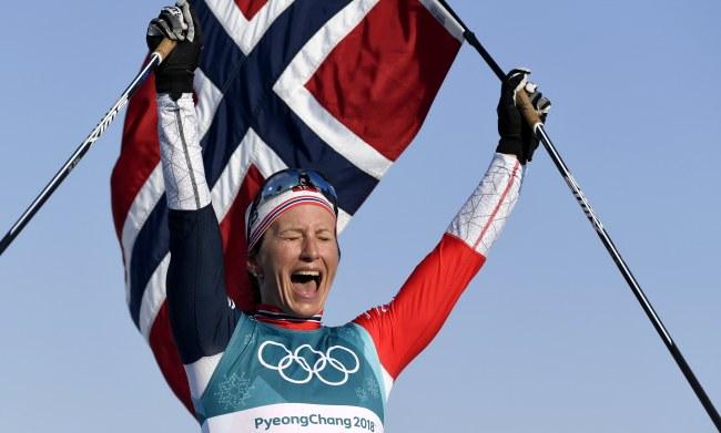 Bjoergen of Norway celebrates winning the Women`s Cross Country 30 km Mass Start Classic race at the Alpensia Cross Country Centre during the PyeongChang 2018 Olympic Games, South Korea, Feb. 25, 2018. (Yonhap)