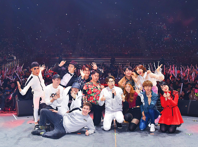YouTubers pose during the curtain call for The YouTube Fan Fest, which took place at Olympic Stadium's Olympic Hall in southeastern Seoul on Sunday. (YouTube-KPR)