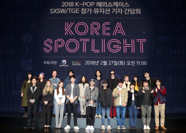 """Musicians who are to perform at the """"Korea Spotlight"""" showcase event of the South by Southwest music festival pose during a press conference in Seoul on Tuesday. (Korea Creative Content Agency)"""