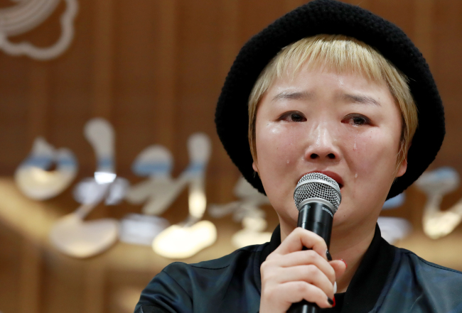 A victim of sexual violence speaks at a press conference. (Yonhap)