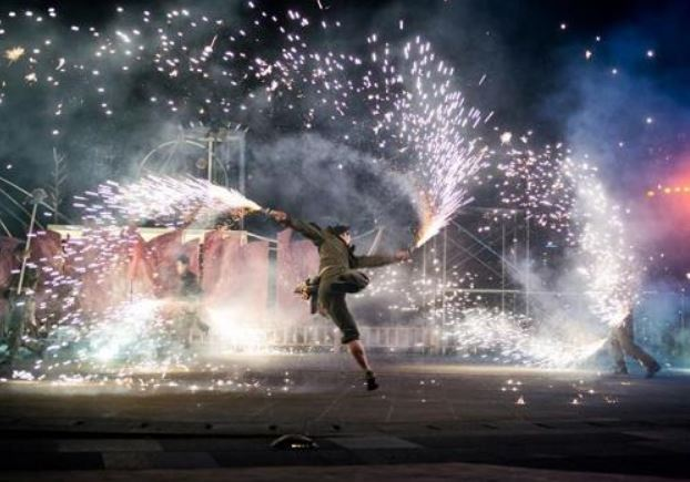 A performer dances with sparklers during