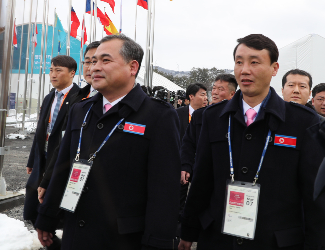 The North Korean delegation to the PyeongChang Winter Paralympics enters the athletes` village in PyeongChang, Gangwon Province, on Wednesday. (Yonhap)