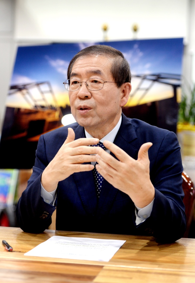 Seoul Mayor Park Won-soon talks in an interview with The Korea Herald on Feb. 23 at his office at Seoul City Hall. Park Hyun-koo/The Korea Herald