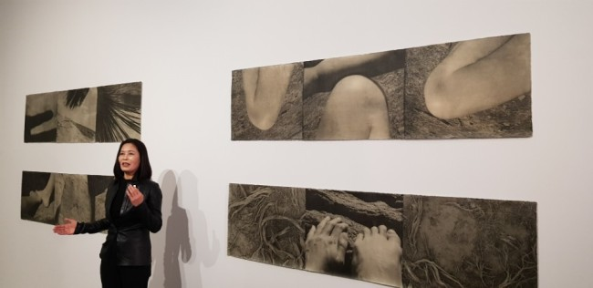 """Photographer Lee Jung-jin speaks in front of her work from """"American Desert"""" series at the MMCA's Gwacheon branch on Tuesday. (MMCA)"""