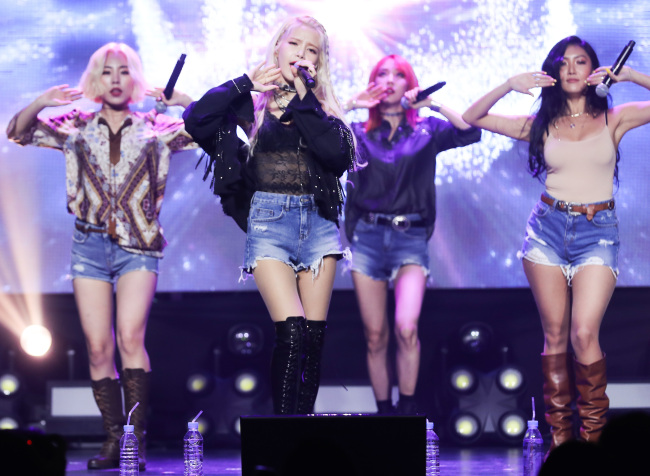 "Mamamoo performs during a media showcase for its new EP ""Yellow Flower"" in Seoul on Wednesday. (Yonhap)"