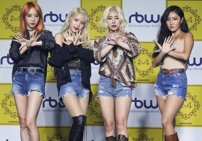 "Mamamoo poses during a media showcase for its new EP ""Yellow Flower"" in Seoul on Wednesday. (Yonhap)"