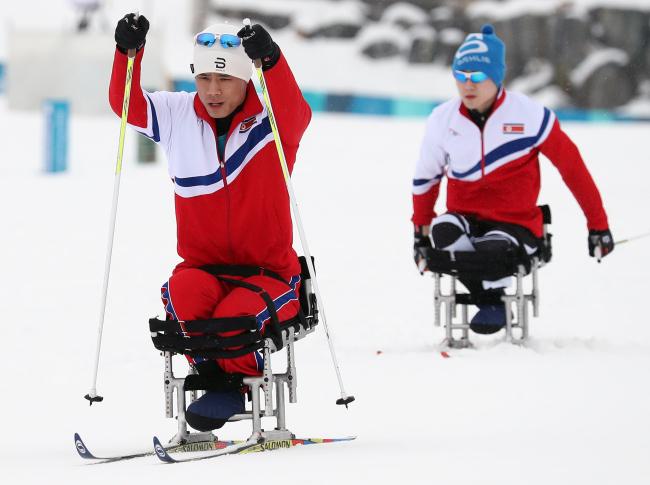 North Korean skier Ma Yu-chol (left) and Kim Jong-hyon (right) train at Alpensia Biathlon Center on Thursday.