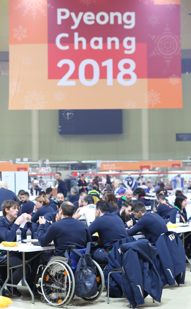 Athletes and officials dine in the athletes' village in Pyeongchang Thursday. (Yonhap)