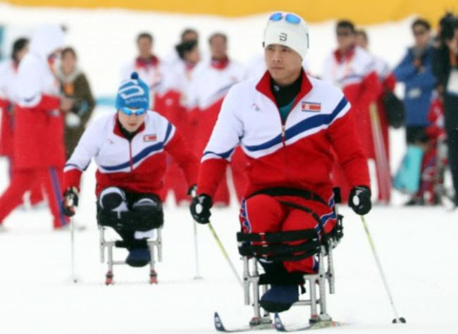 North Korea`s para Nordic skier Ma Yu-chol, front right, and Kim Jong-hyon train for the PyeongChang Winter Paralympics at Alpensia Biathlon Centre in PyeongChang, Gangwon Province, on March 8. (Yonhap)