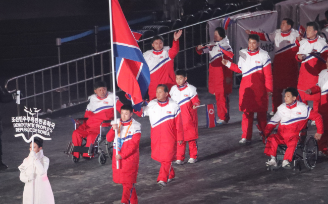 The North Korean team for the PyeongChang Paralympics enters the Olympic Stadium in Gangwon Province at the opening ceremony for the games on Friday. (Yonhap)