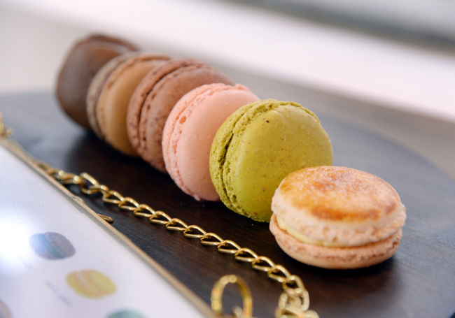The three-seater shop offers a variety of desserts including tarts, macarons, madeleines, dark rum and vanilla-infused caneles and meringues. (Park Hyun-koo/The Korea Herald)