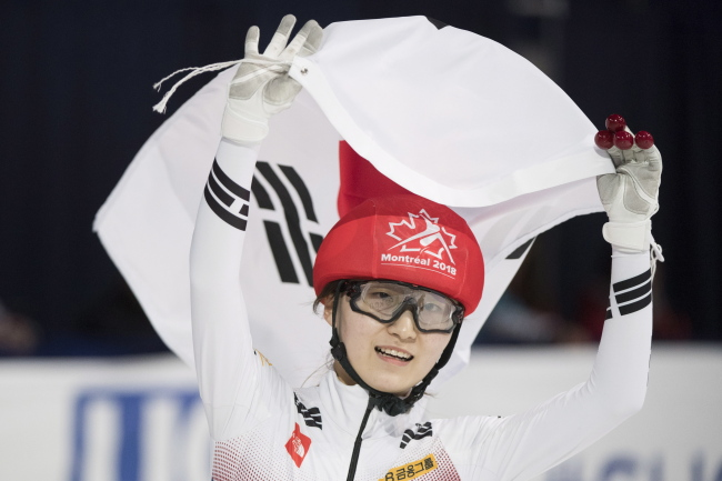 Choi Min-jeong of South Korea celebrates clinching the overall title at the International Skating Union World Short Track Speed Skating Championships at Maurice Richard Arena in Montreal on Sunday. (AP-Yonhap)