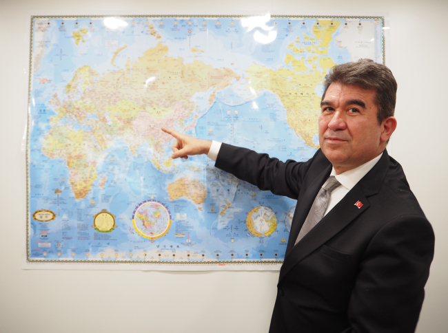 Turkish Ambassador to Korea Ersin Ercin points to the Middle East with which Turkey has had long historic, commercial, cultural, religious and ethnic ties. (Joel Lee/The Korea Herald)
