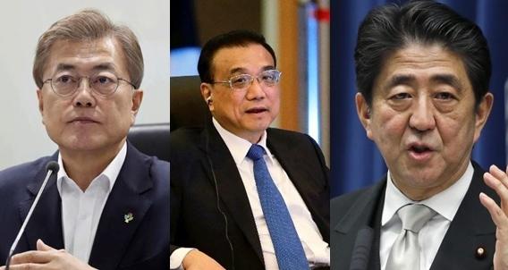 From left: South Korean President Moon Jae-in, Chinese Premier Li Keqiang and Japanese Prime Minister Shinzo Abe. (AP)