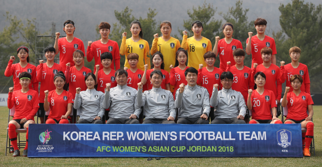 South Korea women`s national football team players and coaching staff pose for a photo at the National Football Center in Paju, north of Seoul on Tuesday. (Yonhap)