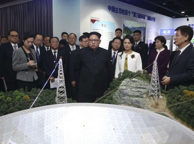 North Korean leader Kim Jong Un, center, and his wife Ri Sol Ju, visit an exhibition highlighting achievements by the Chinese Academy of Sciences on Wednesday, March 28. (Xinhua-AP)
