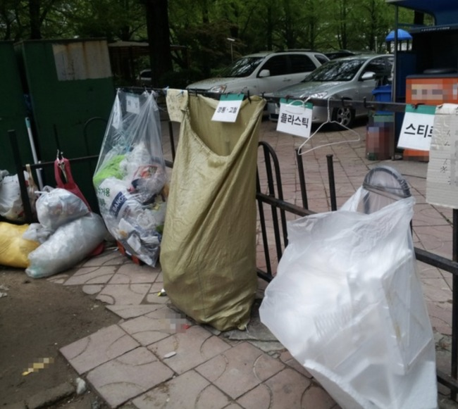 Bags for recycling waste near a residential area in Seoul. Yonhap