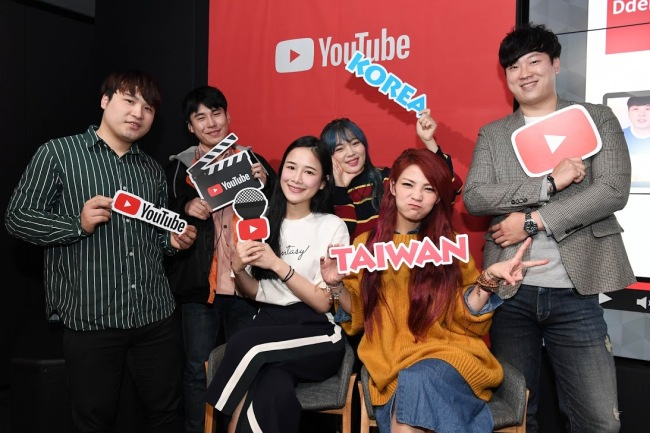 (From left) YouTubers Ddeonggaeddeong, Chien, Sini, A-May and Park Tae-gon pose for a photo after a press conference at Google's Seoul Campus on March 27. (YouTube)