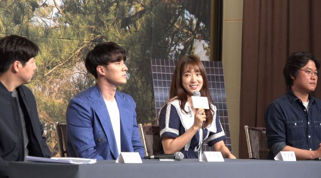 Park Shin-hye says she was happy after picking up many pine cones (Lim Jeong-yeo/The Korea Herald)